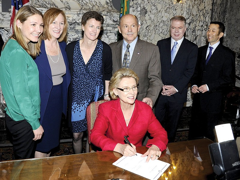 Gov. Christine Gregoire signs the gay-marriage bill Monday.