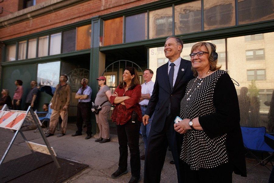 Governor Jay Inslee, second from the right, and his wife Trudi watch a scene being filmed. - YOUNG KWAK