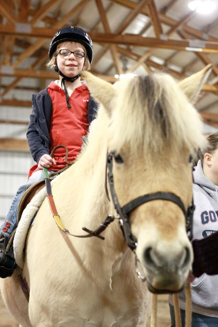 Grace Carney enjoys riding high at Free Rein Therapeutic Riding. - AUSTIN ODELL