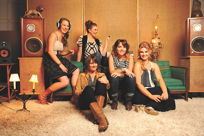 Grammy-nominated Della Mae, which features JayDean Ludiker's daughter, Kimber (seated on the floor). - SARAH WURTZ