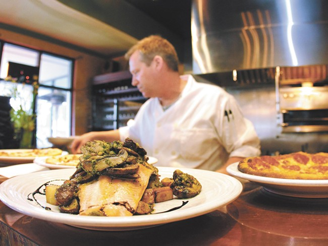 Halibut with potatoes and mushrooms in the foreground. - JOE KONEK