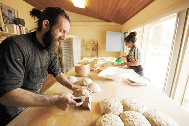 Head baker baker Shaun Thompson Duffy, left, works in the South Hill bakery alongside Alissa Wilde. - YOUNG KWAK