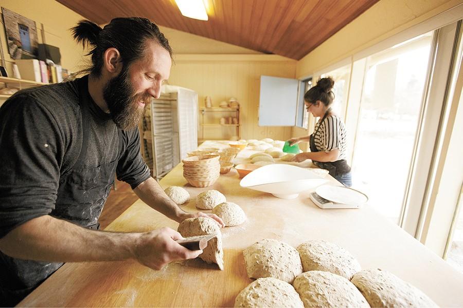 Head baker baker Shaun Thompson Duffy, left, works in the South Hill bakery alongside Alissa Wilde. - YOUNG KWAK