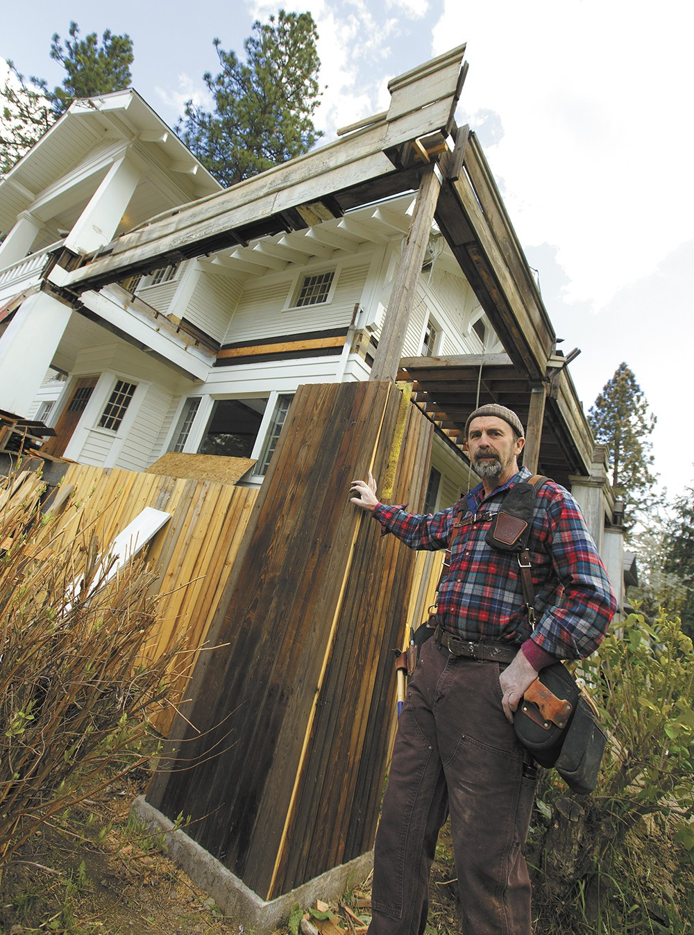 Henry Pierce III next to a Spokane house that's been in his family for three generations. - YOUNG KWAK