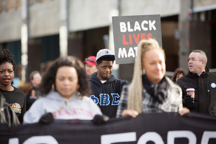 """Holding a """"Black Lives Matter"""" sign, Ivery Rose, center, and other marchers on Spokane Falls Blvd. - YOUNG KWAK"""