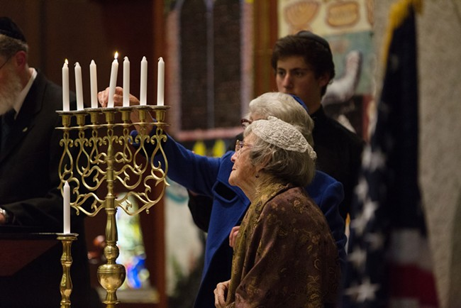 Holocaust survivors Irene Boehm, front, and Carla Peperzak light a candle. - YOUNG KWAK