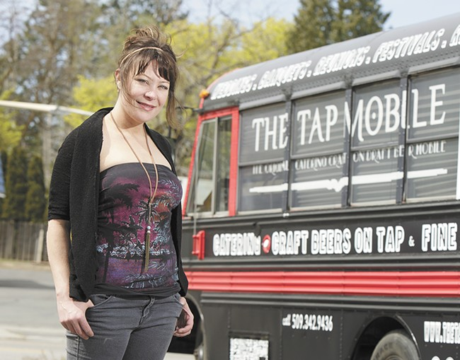 "Hop Shop owner Mel Wood in front of the new Tap Mobile, which she lovingly calls ""Black Betty."" - YOUNG KWAK"