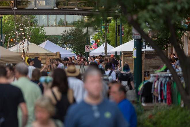 People walk down Wall Street during Terrain's Bazaar. - MATT WEIGAND