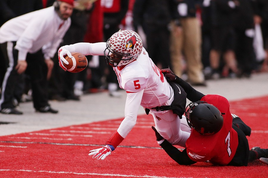 Illinois State quarterback Tre Roberson (5) stretches the ball forward as he is brought down by Eastern Washington defensive back Tevin McDonald (7) during the second half. - YOUNG KWAK