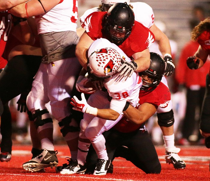 Illinois State running back Jamal Towns (38) is brought against Eastern Washington defensive lineman Matthew Sommer, top, and linebacker Miquiyah Zamora during the second half. - YOUNG KWAK
