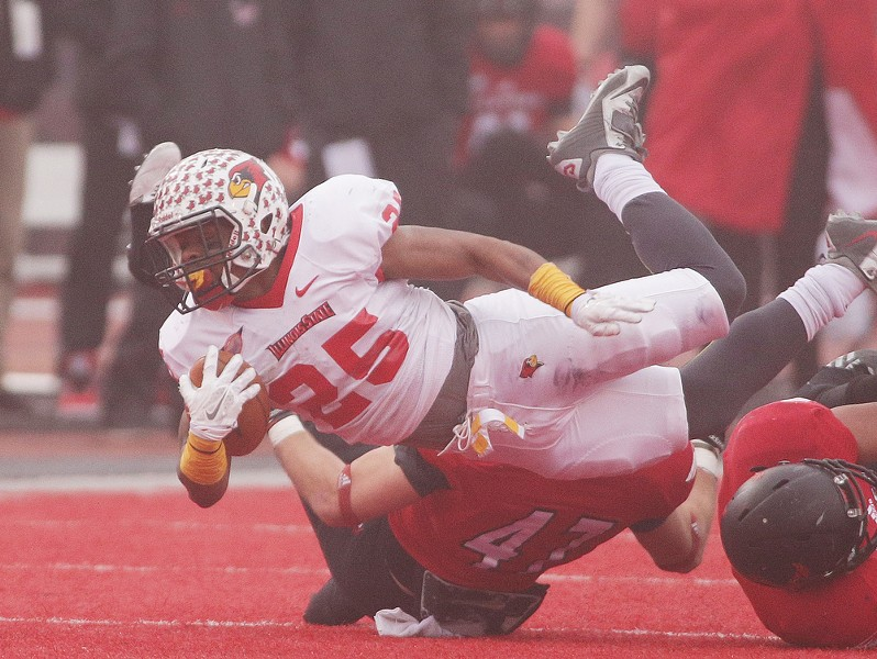 Illinois State running back Marshaun Coprich (25) is brought down by Eastern Washington linebacker Cody McCarthy (47) during the first half. - YOUNG KWAK