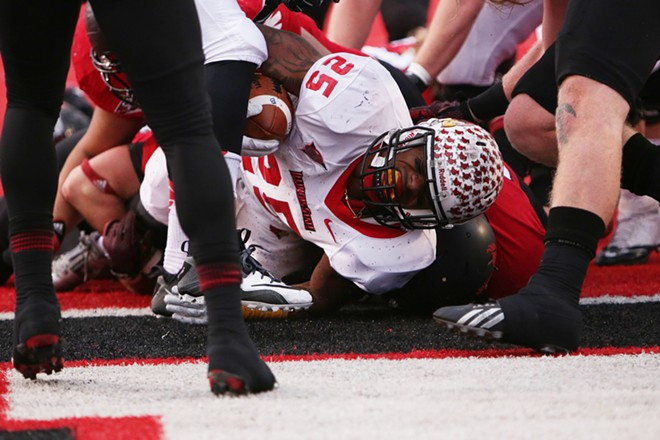 Illinois State running back Marshaun Coprich (25) scores a touchdown against Eastern Washington during the second half. - YOUNG KWAK