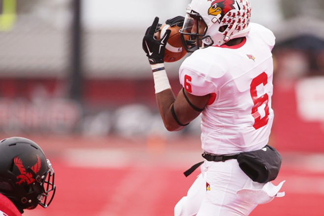Illinois State wide receiver Jon-Marc Anderson (6) catches pass against Eastern Washington defensive back Tevin McDonald during the first half. - YOUNG KWAK