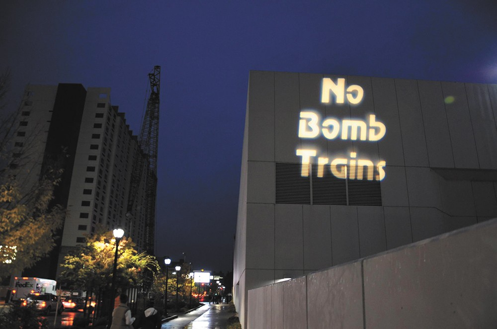 In October, Occupy Spokane protesters projected anti-oil train slogans onto the side of the Spokane Convention Center.