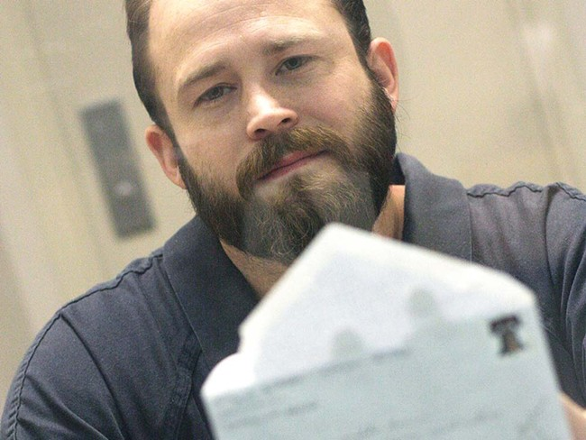 Inmate Rich Sullivan holds an undelivered letter he wrote to jail office supervisor Lynnette Brown at the jail last fall - YOUNG KWAK