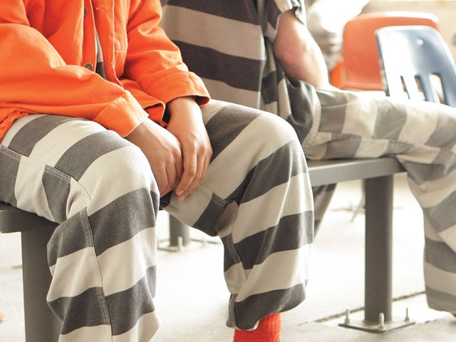 Inmates at Geiger, where nearly 50 percent of the staff has been laid off in the past two weeks. - YOUNG KWAK