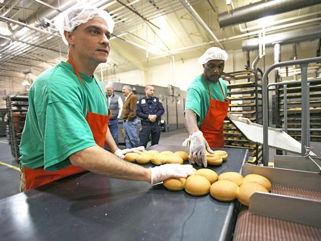 Inmates Richard Dunn, left, and David Michols package buns. - YOUNG KWAK