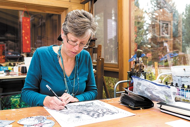 Instructor Loretta West works on a large Zentangle in her home studio. - STEPHEN SCHLANGE