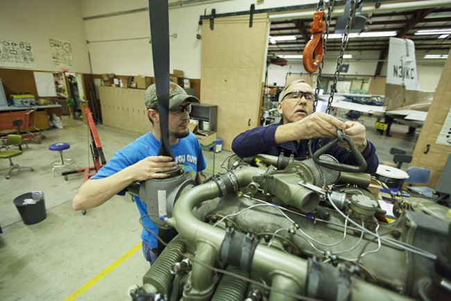 Instructor Richard Kness, right, and third year student David Hoover prepare to lift a Continental 10360 engine. - YOUNG KWAK