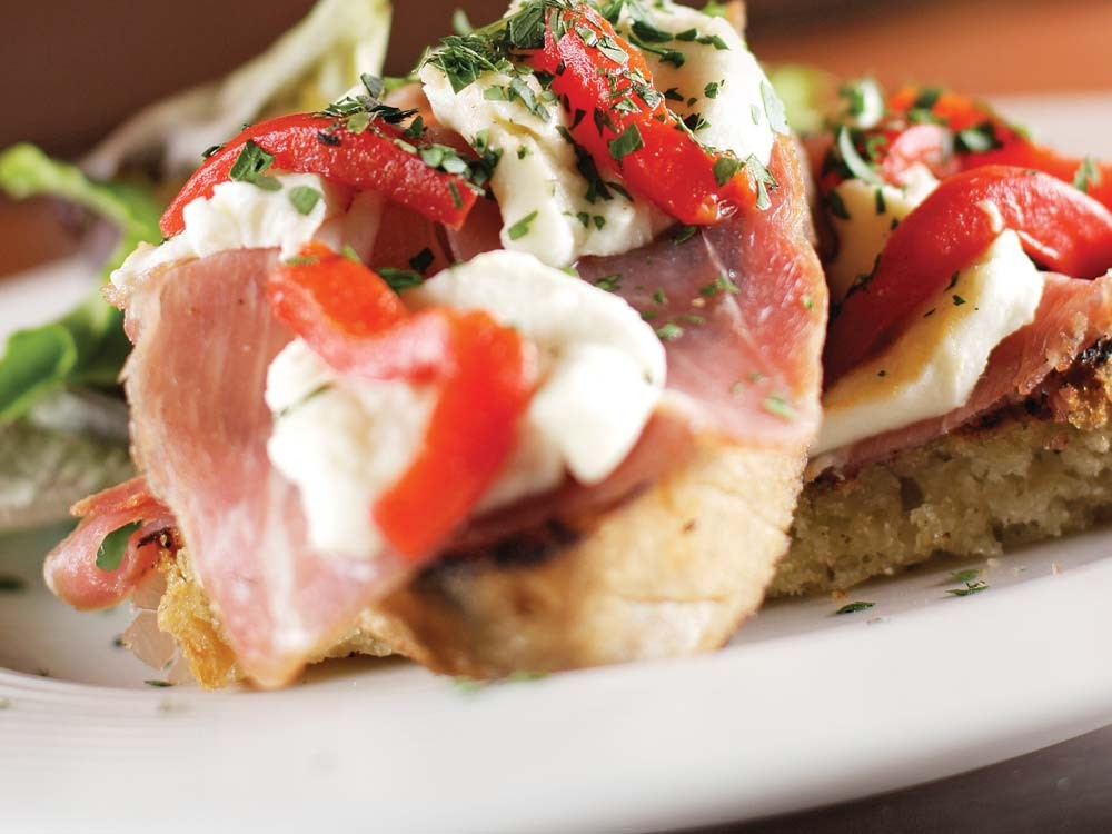 Italia Trattoria's prosciutto bruschetta with roasted red peppers and fresh mozzarella. - YOUNG KWAK
