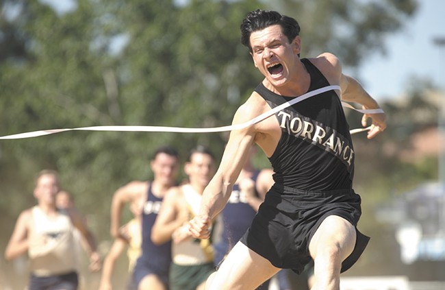 Jack O'Connell as real-life hero Louis Zamperini.