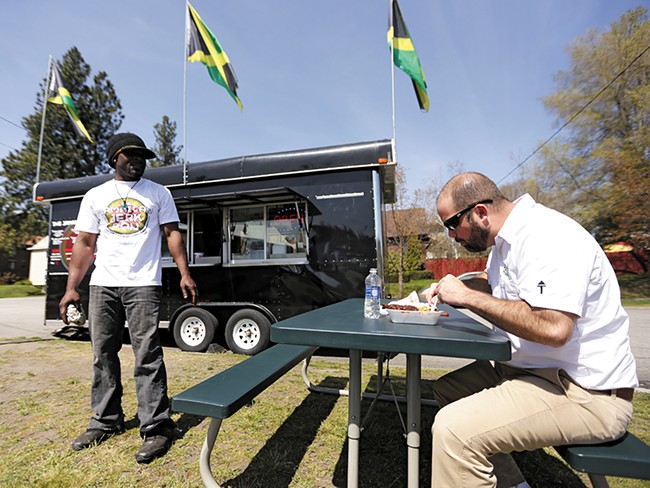 Jamaican Jerk Pan co-owner Roian Doctor with his food truck, which was almost towed by the city last week. - YOUNG KWAK