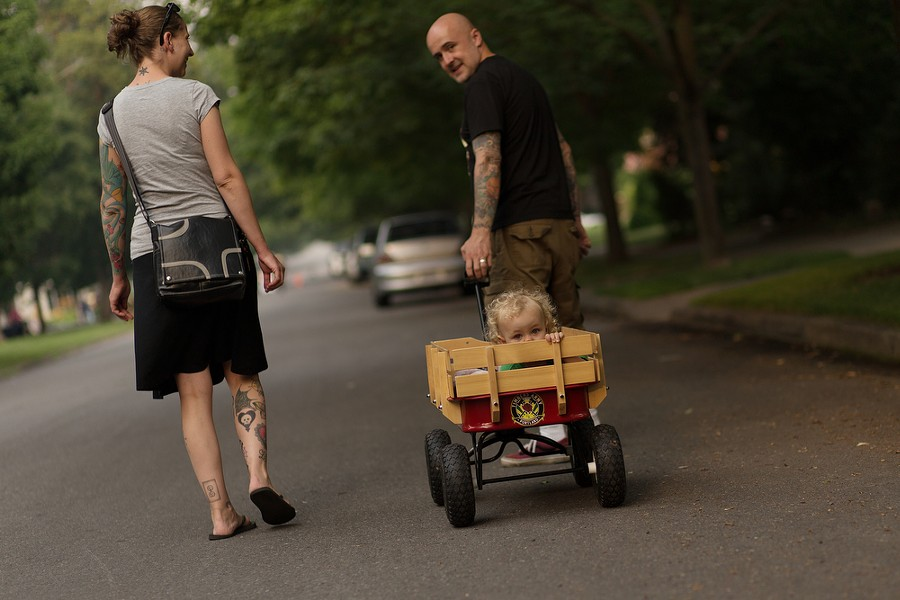 Jamey Calhoun and his wife Hayley, with their 2-year-old daughter Elsa in a wagon. - YOUNG KWAK