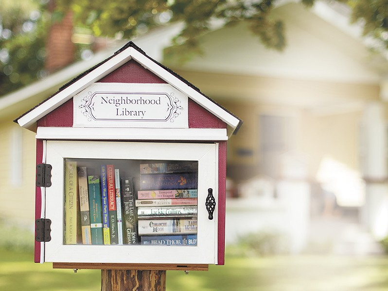 Jan Hansen's little library in northwest Spokane. - YOUNG KWAK