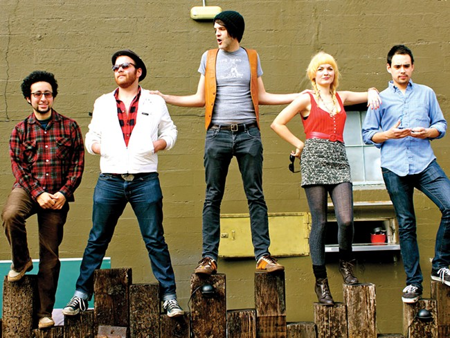 Jared Mees (center) and his band, the Grown Children