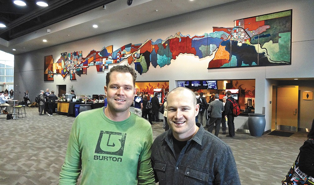Jason (left) and Ben Joyce at the Spokane Convention Center with the large piece they created. - PHOTO COURTESY BEN JOYCE