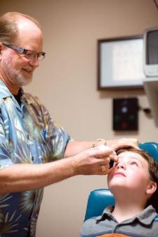 Jason Stone gets an eye exam by Dr. Jeffrey Snow. - RACHEL SCHELL