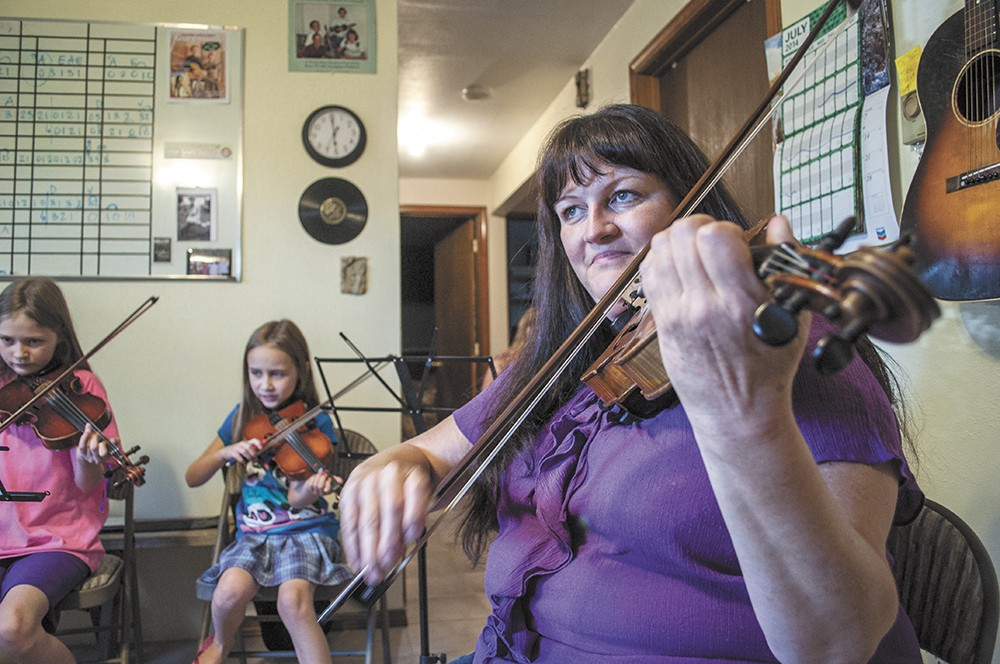 JayDean Ludiker leads a group lesson at her studio in Spokane Valley. - SARAH WURTZ