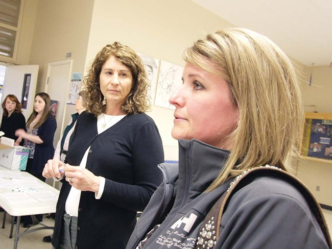 Jefferson Elementary School teacher Gail Madsen, right, talks about layoffs, with Human Resources Specialist Diana Shelton. - YOUNG KWAK