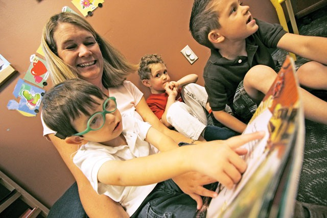 Jennie Wheaton reads to 4-year-old Santiago at the HOPE school. - YOUNG KWAK