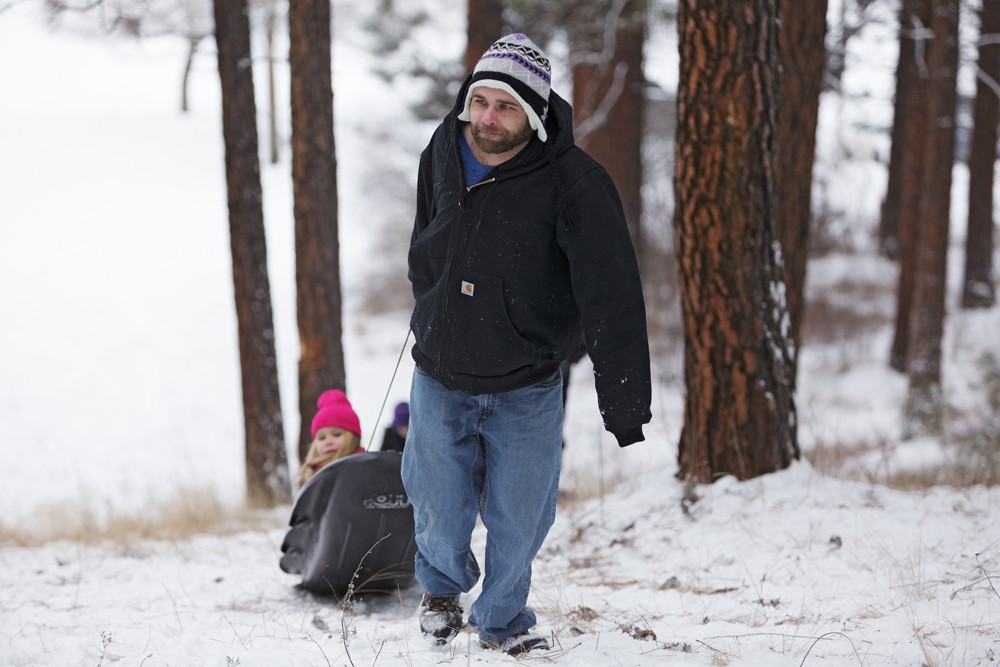 Jeremy Swanson pulls his daughter Saveena, 5, on a sled at Underhill Park. - YOUNG KWAK