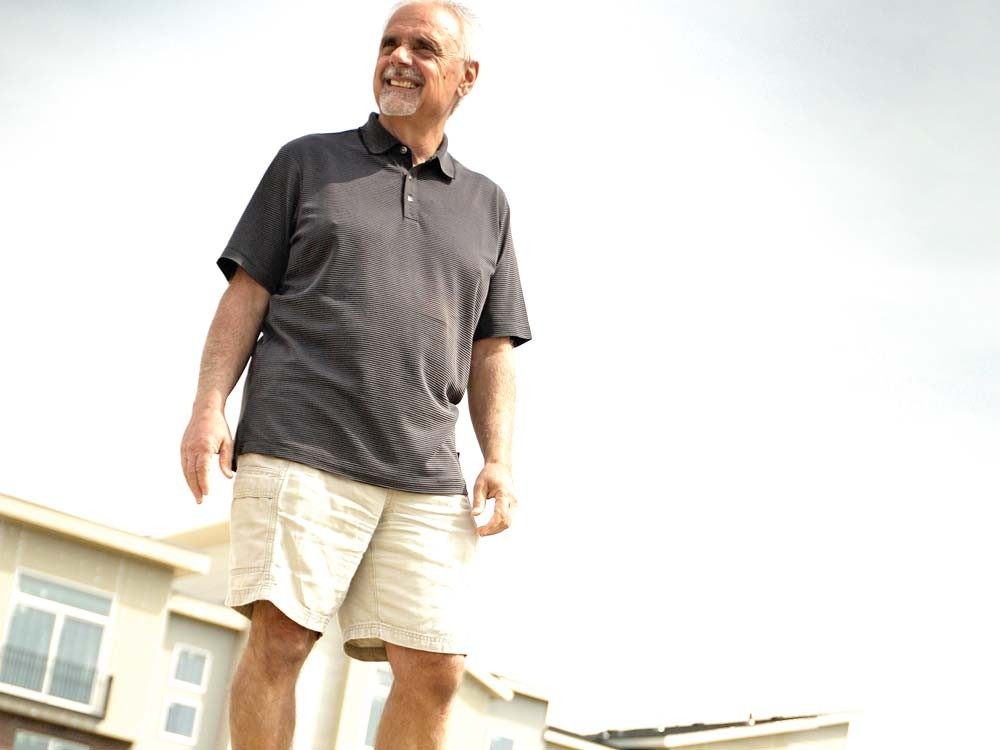 Jim Frank, CEO and founder of Greenstone, standing in Kendall Yards. - YOUNG KWAK