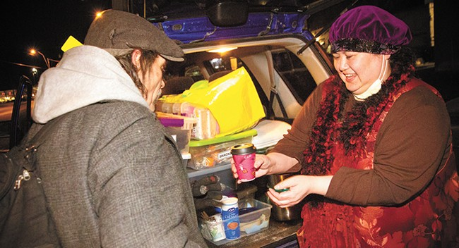 Joan Medina hands out coffee and food to Spokane's homeless population. - JENNIFER DEBARROS