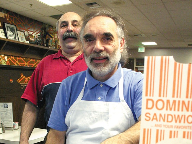 Joe Domini, with brother Tom in the background, is ending his career in the sandwich business. - CHRIS BOVEY