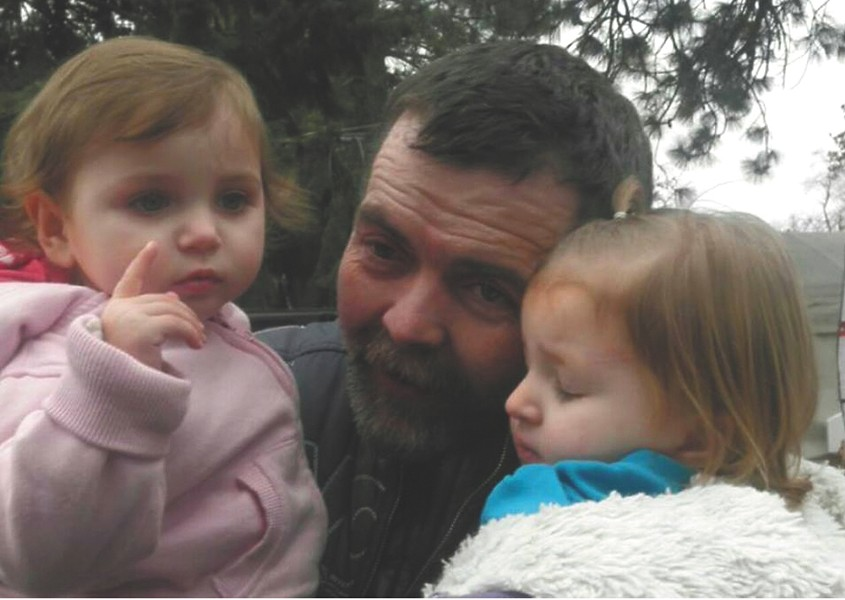 John Everitt with his granddaughters.