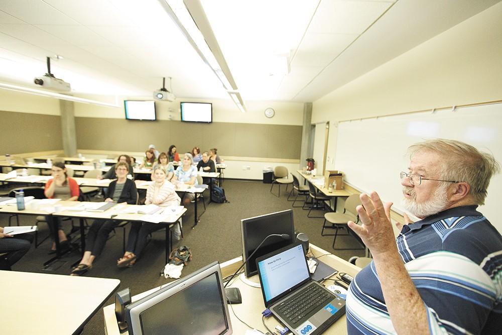 John Murphy leads a Mental Health First Aid class earlier this year at WSU Spokane. - YOUNG KWAK