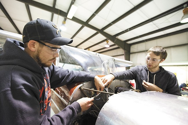Josh Newburg, left, and Nick Bell install solenoids. As a quarter of Boeing machinists prepare to retire, Washington has rushed to train new aerospace employees through conduits like Spokane Community College's aviation program. - YOUNG KWAK