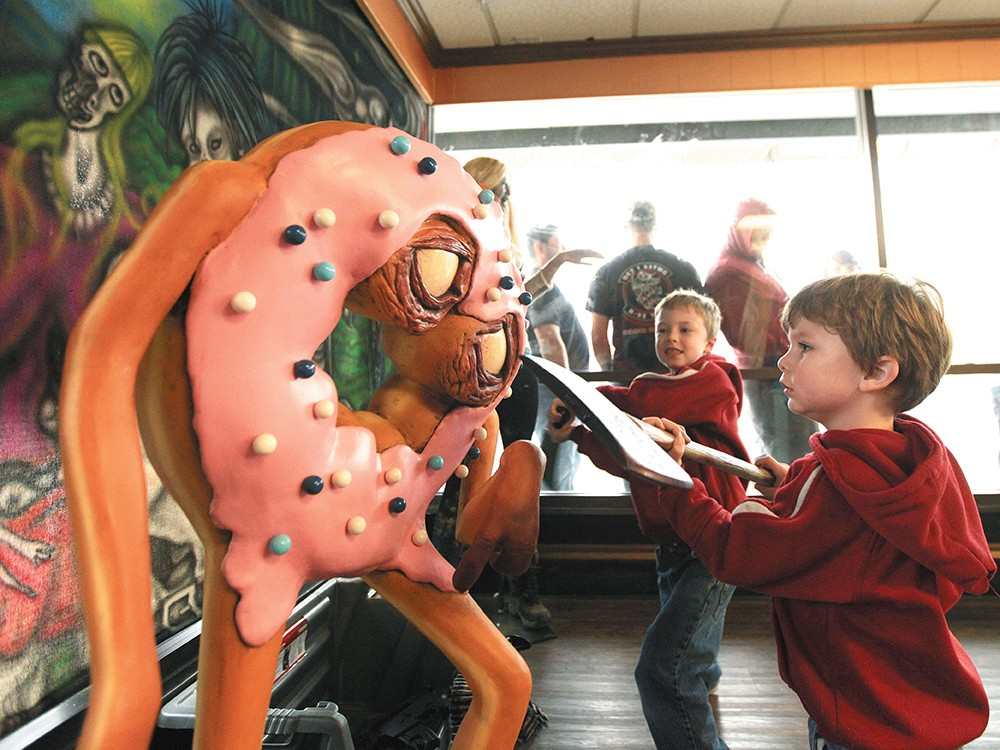 J.T. Sutherland, right, and his brother, Noah, take the ax to a donut zombie. - YOUNG KWAK