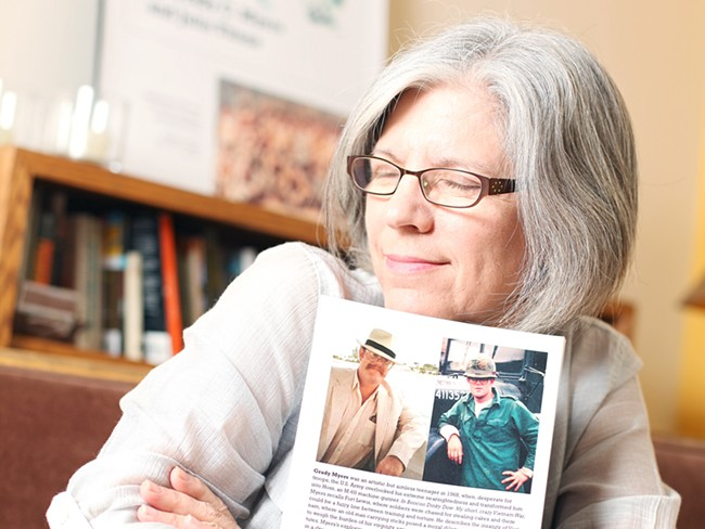 Julie Titone with a copy of Boocoo Dinky Dow, her late ex-husband's war memoir. - YOUNG KWAK