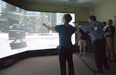 Local media representatives go through video simulations wearing the cameras. - JACOB JONES