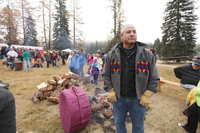Kalispel Tribe Cultural Program Assistant Director J.R. Bluff keeps a drum warm. - YOUNG KWAK