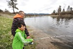 Kalispel Tribe of Indians Vice Chair Ray Pierre III, left, helps his 8-year-old son Ezra fish along the Pend Oreille River on the Kalispel Reservation on April 21.