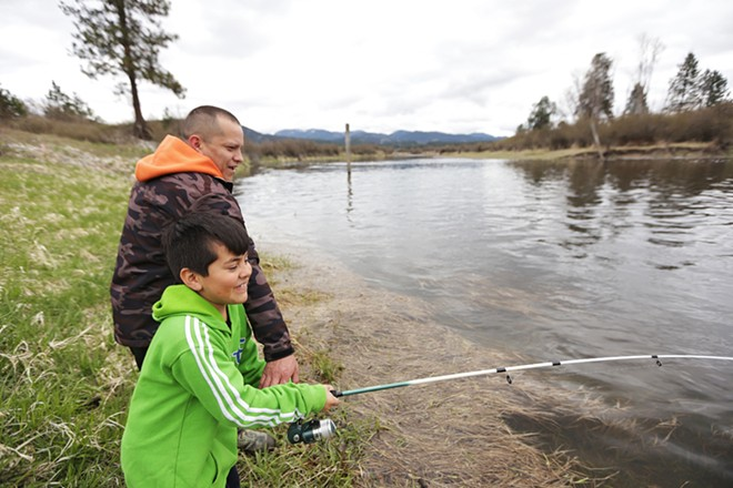 Kalispel Tribe of Indians Vice Chair Ray Pierre III, left, helps his 8-year-old son Ezra fish along the Pend Oreille River on the Kalispel Reservation on April 21. - YOUNG KWAK