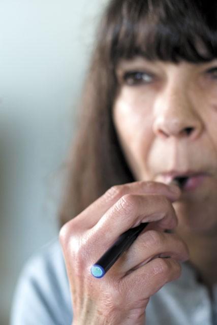 Karen Sacco quit her two-packs-a-day habit using e-cigs. - STEPHEN SCHLANGE