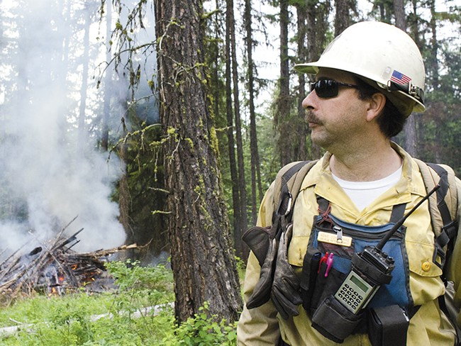 Kent Contreras, with the Forest Service, helps oversee a recent wildfire training exercise near Usk, about an hour north of Spokane. - JACOB JONES
