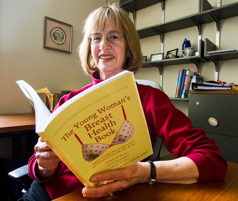 Kerry Anne McGinn with the latest edition of her book: Even knowing that having breast pain does not mean you have breast cancer is... very reassuring. - STEPHEN SCHLANGE